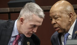 The House Select Committee on Benghazi Chairman Rep. Trey Gowdy, R-S.C., left, confers with Rep. Elijah Cummings, D-Md., the ranking member on Capitol Hill in Washington, Tuesday, Jan. 27, 2015,  at the start of the panel's third public hearing to investigate the 2012 attacks on the U.S. consulate in Benghazi, Libya. (AP Photo/J. Scott Applewhite) ** FILE **