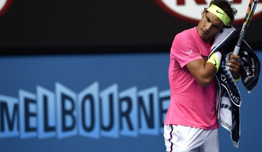 Rafael Nadal of Spain wipes the sweat from the face in his quarterfinal match against Tomas Berdych of the Czech Republic at the Australian Open tennis championship in Melbourne, Australia, Tuesday, Jan. 27, 2015. (AP Photo/Andy Brownbill)