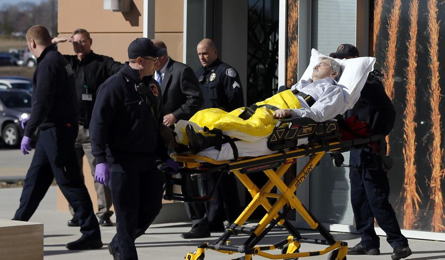 Iowa Gov. Terry Branstad is taken to a hospital after he fell ill at an event Monday, Jan. 26, 2015, in Johnston, Iowa. Branstad's  spokesman said he was conscious during the ambulance ride and that the governor has been fighting a cold. (AP Photo/The Register, Zach Boyden-Holmes)