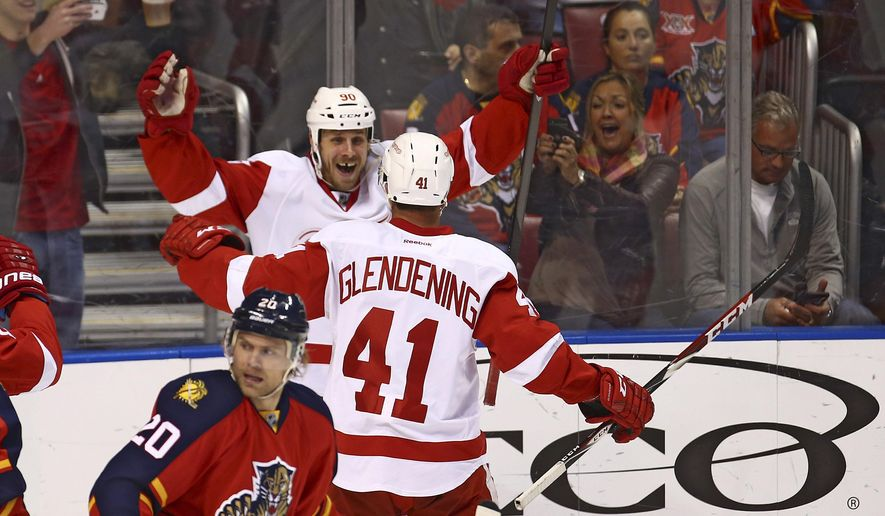 Detroit Red Wings' Stephen Weiss (90) celebrates with Luke Glendening (41) after Glendening scored a goal during the second period of an NHL hockey game against the Florida Panthers, in Sunrise, Fla., Tuesday, Jan. 27, 2015. (AP Photo/J Pat Carter)
