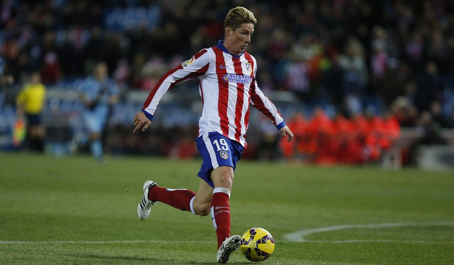 Atletico's Fernando Torres controls the ball during a Spanish La Liga soccer match between Atletico Madrid and Rayo Vallecano at the Vicente Calderon stadium in Madrid, Spain, Saturday, Jan. 24, 2015. (AP Photo/Andres Kudacki)