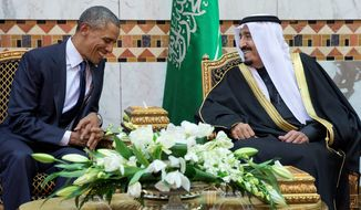 President Obama meets new Saudi Arabian King Salman bin Abdul Aziz in Riyadh, Saudi Arabia, Tuesday, where he and the and first lady have come to expresses their condolences on the death of the late Saudi Arabian King Abdullah bin Abdulaziz al-Saud. Mr. Obama was mum on human rights issues in the country. (Associated Press)
