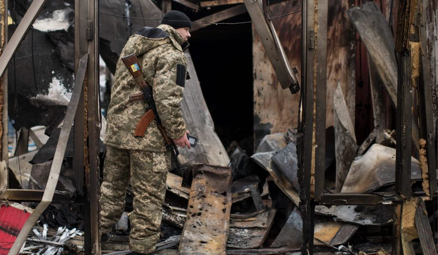 Saturday's rocket strikes at Mariupol, Ukraine destroyed a market and killed 30 people. (Associated Press)