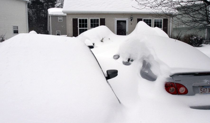 Cars are buried by drifted snow from a winter snowstorm, Tuesday, Jan. 27, 2015, in Marlborough, Mass. A storm packing blizzard conditions spun up the East Coast early Tuesday, pounding parts of coastal New Jersey northward through Maine with high winds and heavy snow. (AP Photo/Bill Sikes)