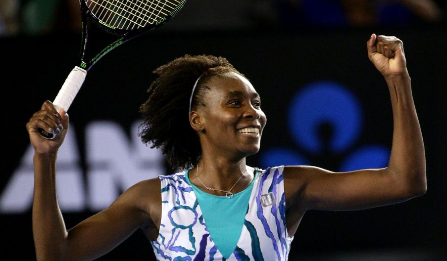 Venus Williams of the U.S. celebrates after winning over Agnieszka Radwanska of Poland in their fourth round match at the Australian Open tennis championship in Melbourne, Australia, Monday, Jan. 26, 2015. (AP Photo/Rob Griffith)