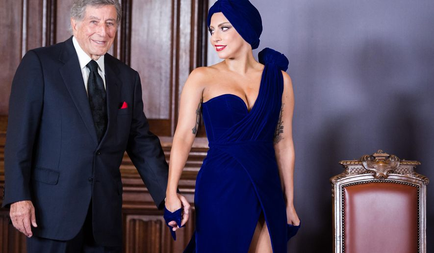 FILE- In this Sept. 22, 2014, file photo, Lady Gaga, right, and Tony Bennett arrive for a media event at the Brussels' city hall. The Grammy Awards will feature a number of collaborative performances, including Lady Gaga with Tony Bennett, The Recording Academy said Tuesday, Jan. 27, 2015. (AP Photo/Geert Vanden Wijngaert, File)