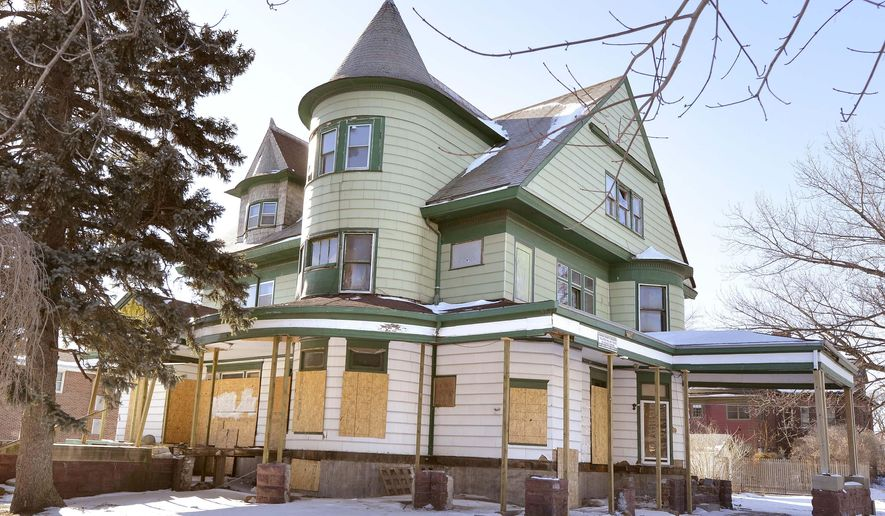 the red-tagged  Rose Hill mansion at 1529 Grandview Boulevard in Sioux City, Iowa, is shown Monday, Jan. 12, 2015. Sioux City officials have granted the owner of the historic mansion one last opportunity to restore the building and save it from demolition. (AP Photo/The Sioux City Journal, Tim Hynds)