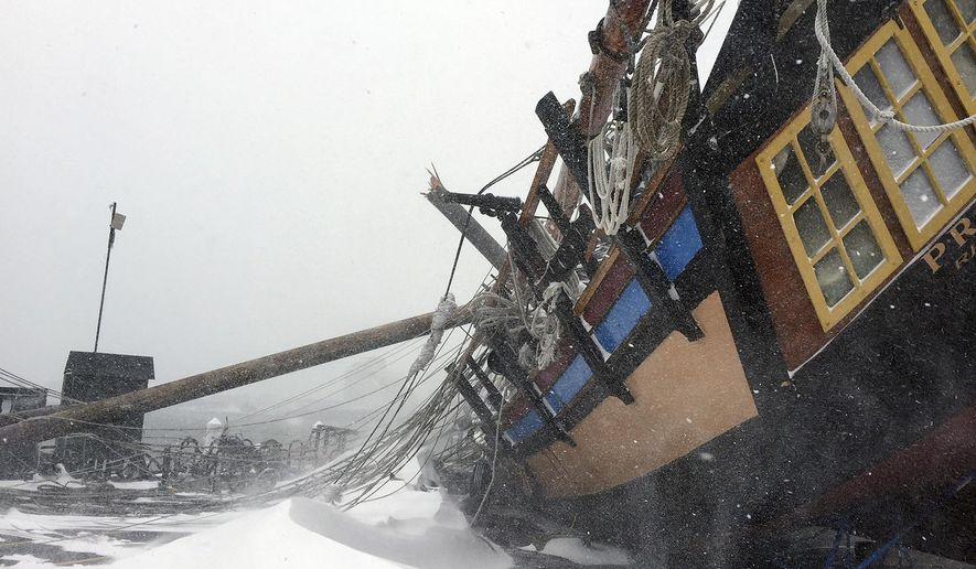In this photo provided by Rocky Steeves, Rhode Island's tall ship, a replica of the USS Providence, rests on its side on the dock at at the Newport Shipyard after strong wind gusts topped it during the snowstorm Tuesday, Jan. 27, 2015, in Newport, R.I. Owner and captain Thorpe Leeson said the ship, stored there for the winter, sustained extensive damage. (AP Photo/Rocky Steeves)