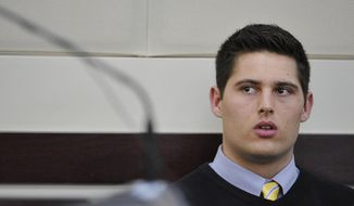 Defendant Brandon Vandenburg listens as his attorney Fletcher Long argues for acquittal during the his trial Monday, Jan. 26, 2015, in Nashville, Tenn. Former Vanderbilt football players Vandenburg and Cory Batey are standing trial on five counts of aggravated rape and two counts of aggravated sexual battery.  (AP Photo/Larry McCormack, Pool)