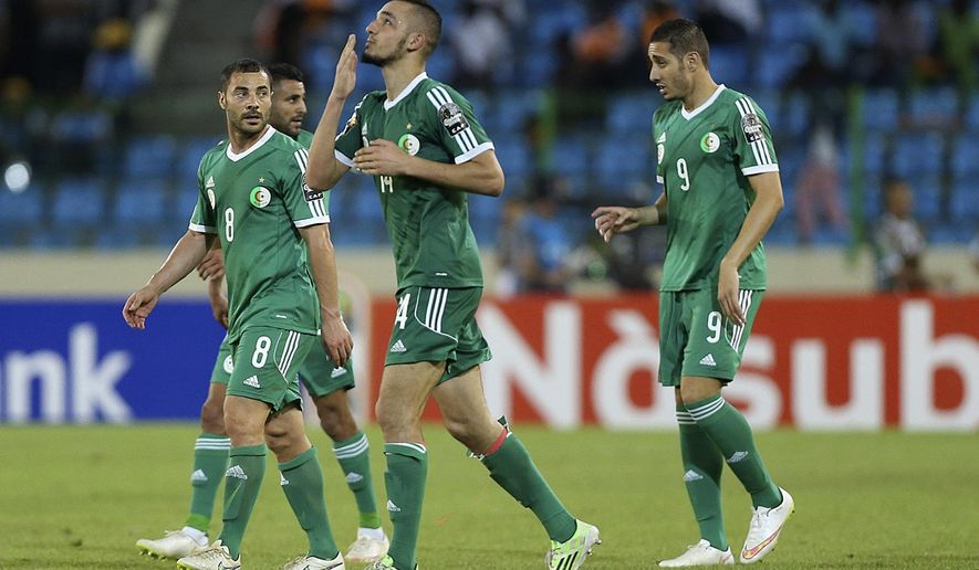 Algeria's,  Nabil Bentaleb, centre, celebrates after he  scored a goal against Senegal  during  their final Group C African Cup of Nations soccer match  at Estadio De Malabo in Malabo, Equatorial Guinea, Tuesday, Jan. 27, 2015. (AP Photo/Sunday Alamba)