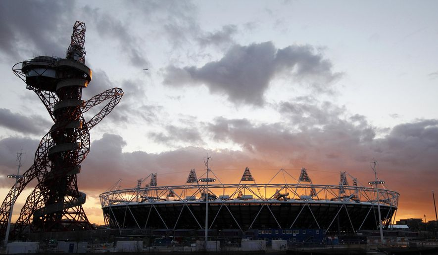 FILE - In Wednesday, March  7, 2012 file photo, the London 2012 Olympic Stadium at sunset at the Olympic Park in London. The Smithsonian Institution is working to establish its first international museum outpost in London as that city redevelops its Olympic park. Smithsonian officials announced Tuesday, Jan. 27, 2015 that London's mayor and developers have secured $50 million in private contributions to build the facility. (AP Photo/Alastair Grant, File)