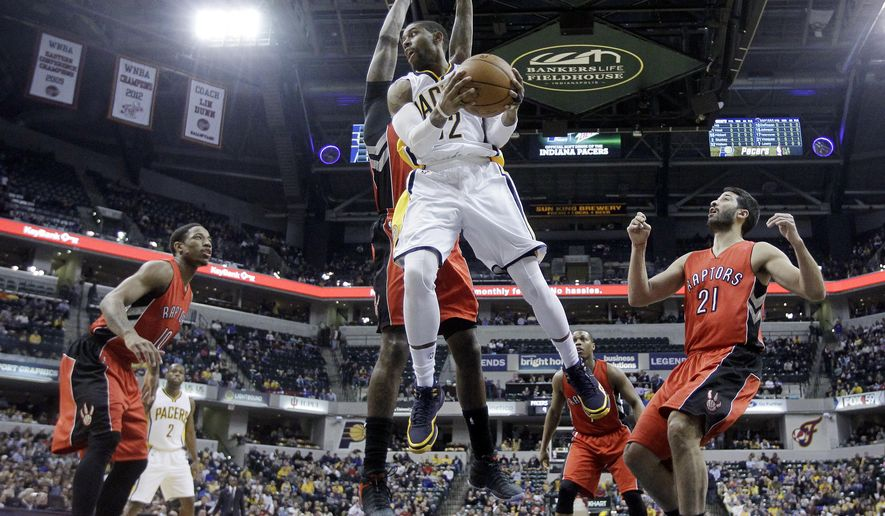 Indiana Pacers' C.J. Watson (32) looks to make a pass during the first half of an NBA basketball game against the Toronto Raptors Tuesday, Jan. 27, 2015, in Indianapolis. (AP Photo/Darron Cummings)