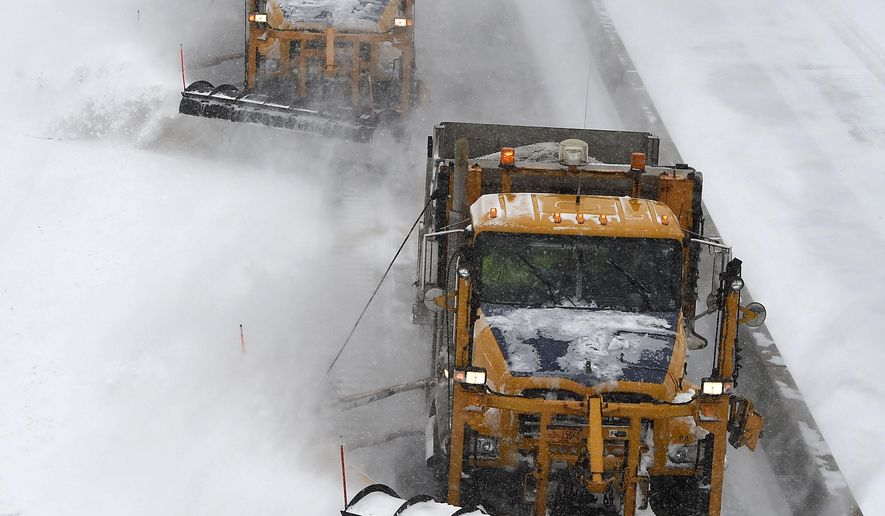 New York State Department of Transportation plows clear snow off the Long Island Expressway after it was reopened on Tuesday, Jan. 27, 2015, in Melville, N.Y. The Expressway and other roads were closed after a blizzard hit the New York area overnight into this morning. (AP Photo/Kathy Kmonicek)(AP Photo/Kathy Kmonicek)