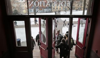 University of Wisconsin-Madison students come and go from the Education Building between classes at the public university in Madison, Wis., Tuesday, Jan. 27, 2015. (AP Photo/Wisconsin State Journal, M.P. King)
