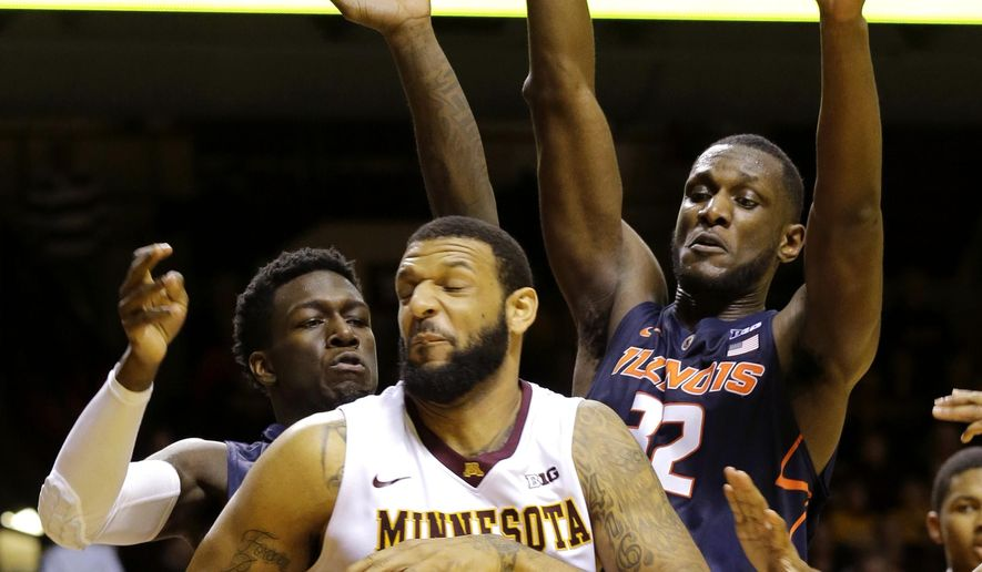 Minnesota forward Maurice Walker, center, is pressured by Illinois guard Kendrick Nunn, left, and Illinois center Nnanna Egwu, right, during the second half of an NCAA college basketball game in Minneapolis, Saturday, Jan. 24, 2015. (AP Photo/Ann Heisenfelt)