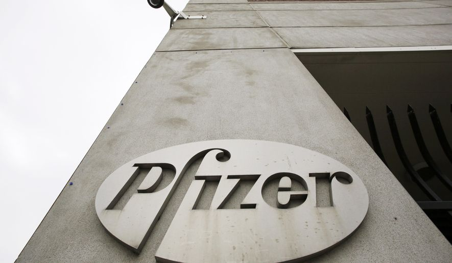 FILE - In this May 4, 2014 file photo, a security camera hangs above the Pfizer logo on the exterior of a former Pfizer factory in the Brooklyn borough of New York. The pharmaceutical giant reports quarterly financial results on Tuesday, Jan. 27, 2015. (AP Photo/Mark Lennihan, File)