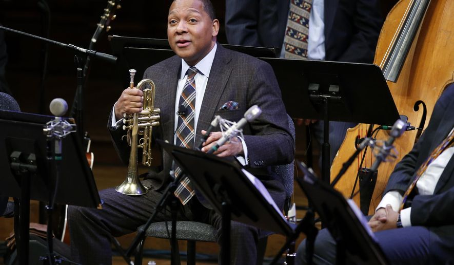 FILE - In this Jan. 30, 2014 file photo, Musician Wynton Marsalis speaks during a lecture performance at Harvard University's Sanders Theatre in Cambridge, Mass. The Jazz at Lincoln Center Orchestra with Wynton Marsalis will tour South America in March for the first time in 10 years. JALC announced Tuesday, Jan 27, 2015, that the 12-city tour kicks off Feb. 27 in New York and will visit Puerto Rico, the U.S. Virgin Islands, Mexico and six South American countries. The program will celebrate the influence of musical traditions from throughout the Americas on jazz. (AP Photo/Elise Amendola, File)