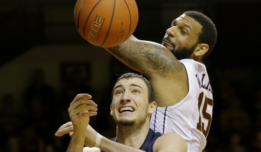 Minnesota forward Maurice Walker (15) and Illinois center Maverick Morgan (22) vie for a rebound during the second half of an NCAA college basketball game in Minneapolis, Saturday, Jan. 24, 2015. Minnesota won 79-71. (AP Photo/Ann Heisenfelt)