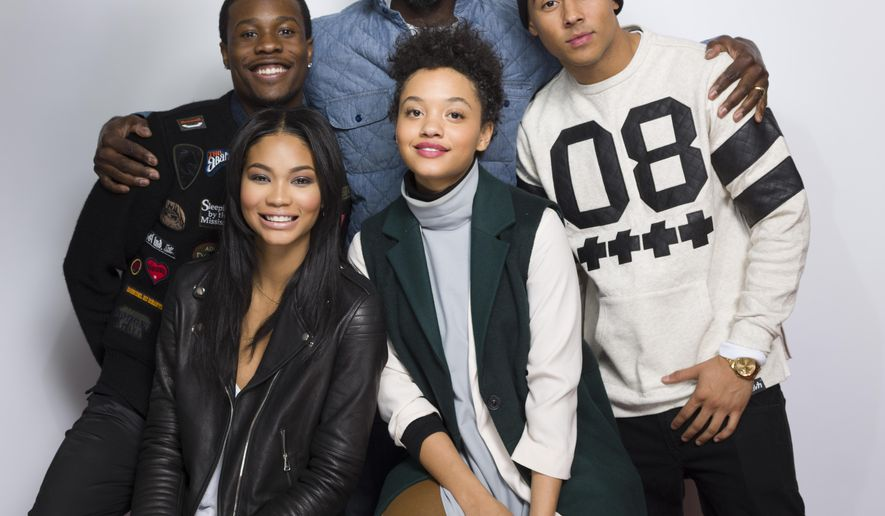 "In this Jan. 24, 2015 photo, Shameik Moore, from top left, director Rick Famuyiwa, Quincy Brown, and from bottom left, Chanel Iman and Kiersey Clemons pose for a portrait to promote the film, ""Dope"", at the Eddie Bauer Adventure House during the Sundance Film Festival n Park City, Utah. (Photo by Victoria Will/Invision/AP)"