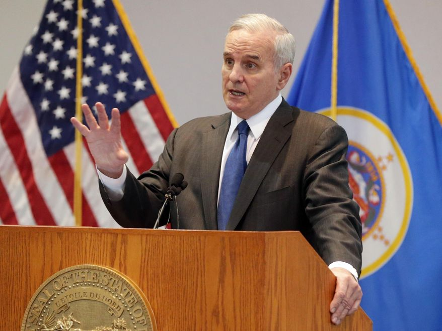Minnesota Gov. Mark Dayton answers questions after he presented his two-year budget proposal which tops $40 billion, Tuesday, Jan. 27, 2015, in St. Paul, Minn. (AP Photo/Jim Mone)