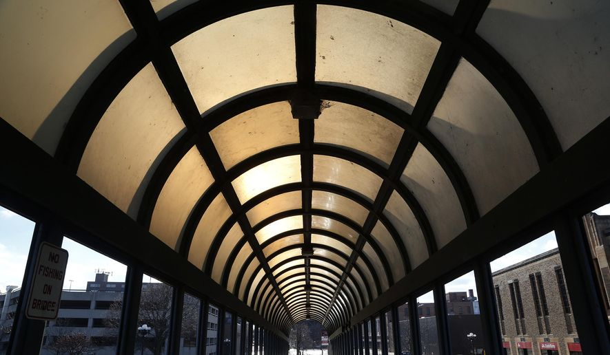 The 4th Street pedestrian bridge is in need of work Monday, Jan. 26, 2015, in Waterloo, Iowa. The city of Waterloo is asking for $2 million toward refurbishing the covered pedestrian walkway on the Fourth Street Cedar River bridge. (AP Photo/Waterloo Courier, Matthew Putney)