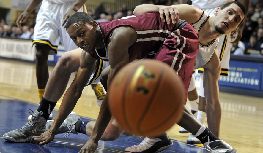 Neither St. Joseph's James Demery, left, nor LaSalle's Steve Zack, right, can take possession of a loose ball during the first half of an NCAA college basketball game, Tuesday, Jan. 27, 2015 in Philadelphia. (AP Photo/The Philadelphia Inquirer, Tom Gralish)  PHIX OUT; TV OUT; MAGS OUT; NEWARK OUT