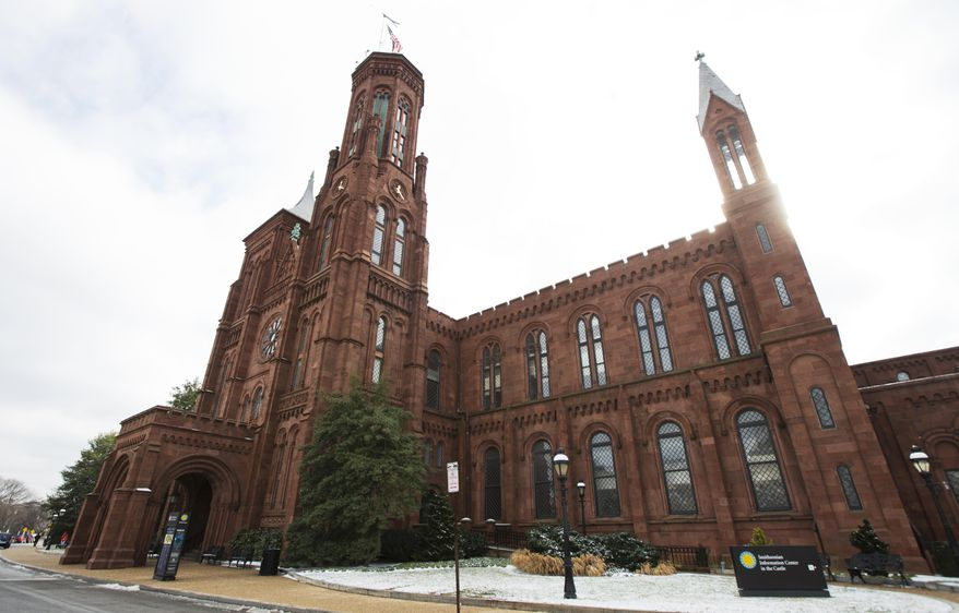 The Smithsonian Institution's Smithsonian Castle is seen at the National Mall in Washington, Tuesday, Jan. 27, 2015. The Smithsonian Institution is working to establish its first international museum outpost in London as the city redevelops its Olympic park. (AP Photo/Manuel Balce Ceneta)