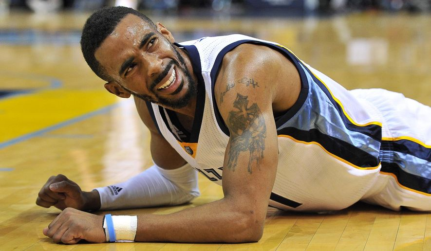 Memphis Grizzlies guard Mike Conley lies on the court after falling in the second half of an NBA basketball game Monday, Jan. 26, 2015, in Memphis, Tenn. (AP Photo/Brandon Dill)