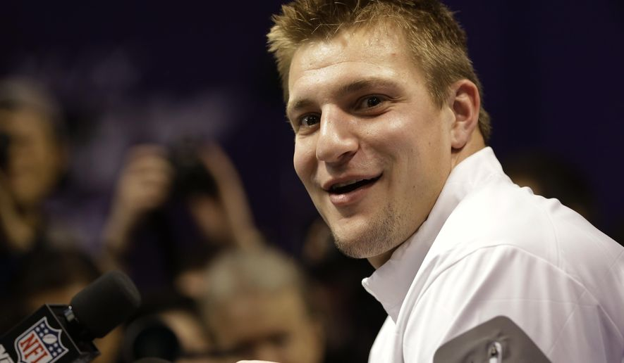 New England Patriots' Rob Gronkowski answers questions during media day for NFL Super Bowl XLIX football game Tuesday, Jan. 27, 2015, in Phoenix. (AP Photo/David J. Phillip)