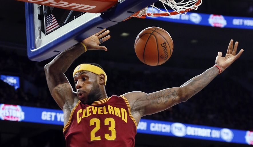 Cleveland Cavaliers forward LeBron James (23) dunks against the Detroit Pistons in the second half of an NBA basketball game in Auburn Hills, Mich., Tuesday, Jan. 27, 2015.  (AP Photo/Paul Sancya)