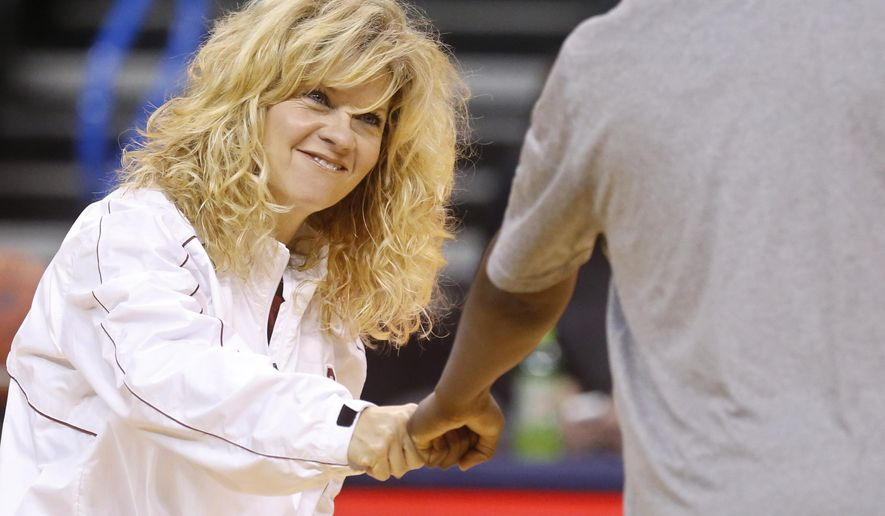 FILE -  In a March 7, 2014, file photo Oklahoma head coach Sherri Coale fist bumps with amember of the team   during a team practice inOklahoma City. The Sooners entered the Top 25 for the first time since 2013 on Monday, Jan. 26, 2015.(AP Photo/Sue Ogrocki, file)