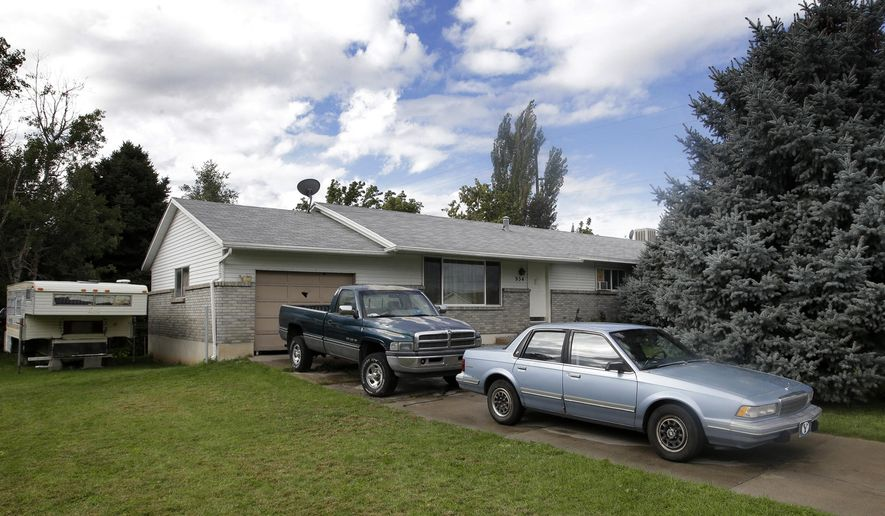 "FILE - This Sept. 28, 2014, file photo, shows the home where five Utah family members were found dead in their home, in Springville, Utah. Police say five members of the Utah family found dead last fall died from methadone and other drugs, and interviews with people who knew them revealed the parents worried about a ""pending apocalypse."" Springville Police Chief J. Scott Finlayson said Tuesday, Jan. 27, 2015, authorities have concluded their investigation into the September deaths of Benjamin and Kristi Strack and three of their children, ages 11, 12 and 14.  (AP Photo/Rick Bowmer, File)"