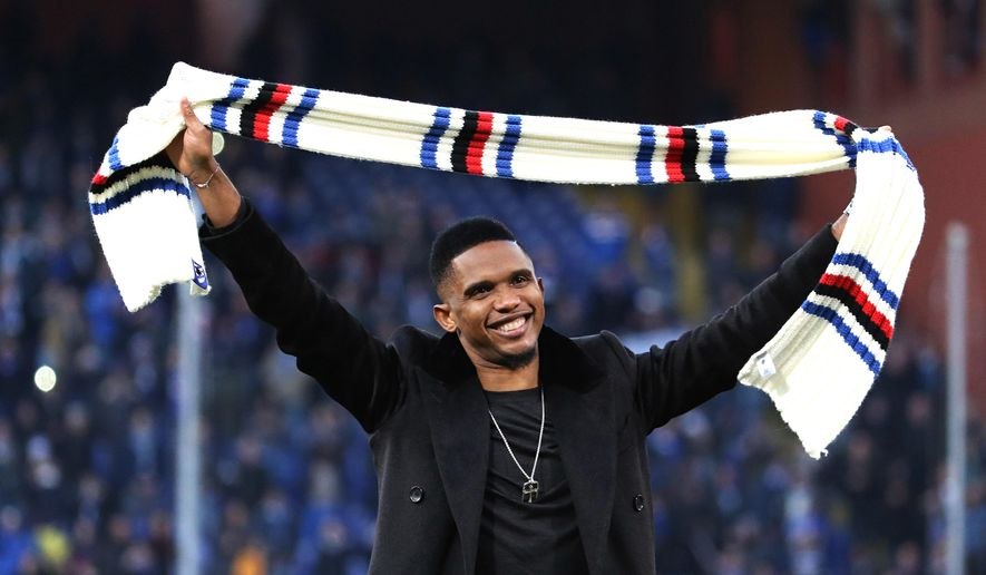 Samuel Eto'o salutes Sampdoria supporters at the end of a Serie A soccer match between Sampdoria and Palermo, in Genoa, Italy, Sunday, Jan. 25, 2015. In Genoa, all eyes were on the stands, where club president Massimo Ferrero sat with a smiling Eto'o and fellow new signing Luis Muriel, with all three wearing Sampdoria scarves. No official comment has been made by either Sampdoria or Everton but Eto'o underwent a successful medical this weekend and will reportedly be presented to the media on Monday after the deal has been finalized. (AP Photo/Carlo Baroncini)
