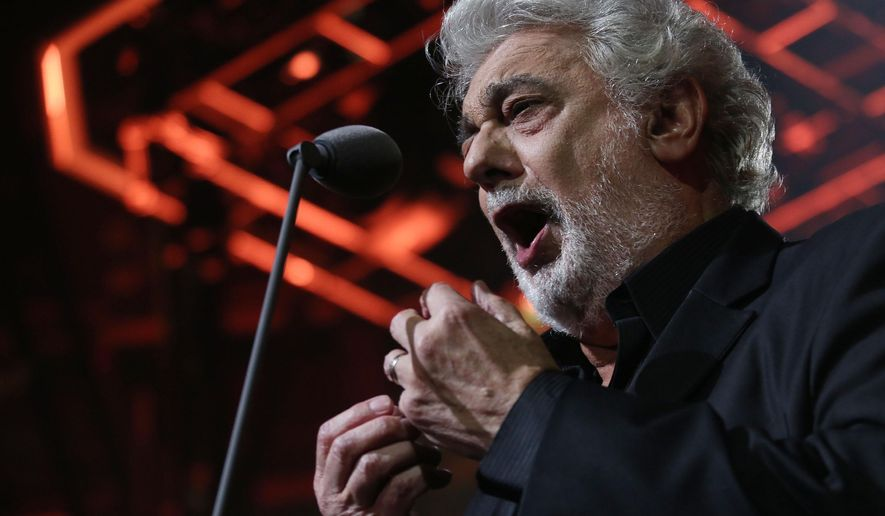 "FILE - In this Sept. 30, 2014 file photo, Placido Domingo performs on stage at the Roundhouse in Camden, North London, as he closes this year's iTunes festival. Domingo will take on his 146th role when he sings the title character of Puccini's ""Gianni Schicchi"" in a Woody Allen production on Sept. 12, the opening night of the Los Angeles Opera 2015-16 season. (Photo by Joel Ryan/Invision/AP, File)"
