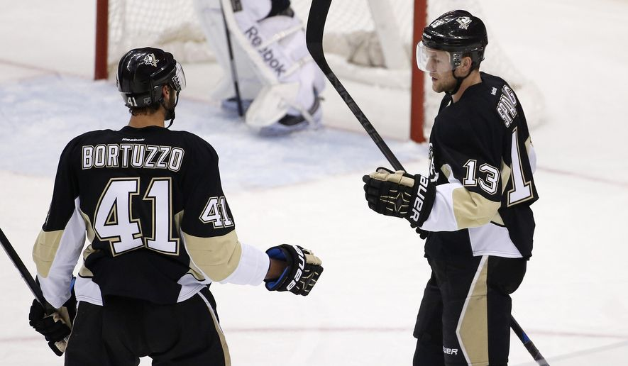 Pittsburgh Penguins' Nick Spaling (13) celebrates his goal with Robert Bortuzzo (41) during the first period of an NHL hockey game against the Winnipeg Jets in Pittsburgh on Tuesday, Jan. 27, 2015.(AP Photo/Gene J. Puskar)