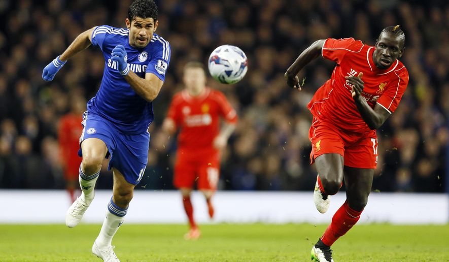 Liverpool's Mamadou Sakho, right, battles for the ball with Chelsea's Diego Costa during the English League Cup semifinal second leg soccer match between Chelsea and Liverpool at Stamford Bridge stadium in London, Tuesday, Jan. 27, 2015. (AP Photo/Kirsty Wigglesworth)