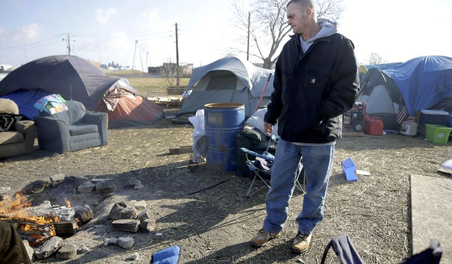 "Chad Bergman stands in a large homeless encampment where he lives and is known as the ""mayor"" Tuesday, Jan. 27, 2015, near downtown St. Louis. The city plans to tear down the camp down due to health and safety concerns, but Human Services director Eddie Roth says officials will work with those living in tents to help them find better alternatives. (AP Photo/Jeff Roberson)"