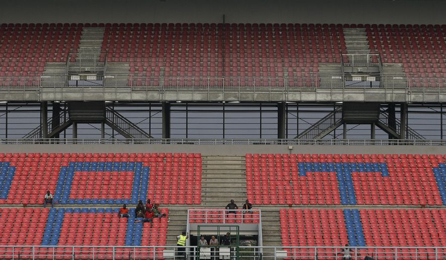 Soccer fans watching the African Cup of Nations Group B soccer match between DR Congo and Tunisia in Bata, Equatorial Guinea, Monday, Jan. 26, 2015. (AP Photo/Themba Hadebe)