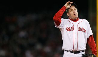 Boston Red Sox pitcher Curt Schilling (38) tips his hat as he walks off the field after being taken out of the game during the sixth inning in Game 2 of the baseball World Series against the Colorado Rockies Thursday, Oct. 25, 2007, at Fenway Park in Boston. (AP Photo/Kathy Willens)