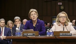 Sen. Elizabeth Warren (center), Massachusetts Democrat, accompanied by Secretary of State Hillary Rodham Clinton (right), make statements introducing Senate Foreign Relations Chairman John Kerry (seated at left), Massachusetts Democrat, to the committee during his Jan. 24, 2013, confirmation hearing to become secretary of state, replacing Clinton, on Capitol Hill in Washington. (Associated Press) **FILE**