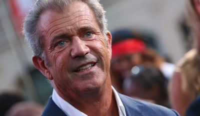 """Mel Gibson arrives at the Lionsgate Los Angeles premiere of """"The Expendables 3"""" at TCL Chinese Theatre on Monday, Aug. 11, 2014, in Hollywood, Calif. (Photo by Alexandra Wyman/Invision for Lionsgate/AP Images)"""