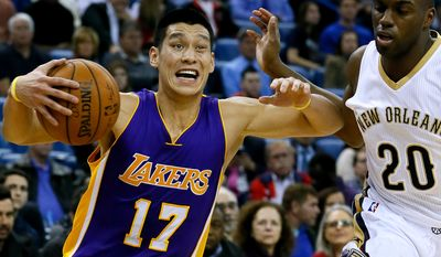 Los Angeles Lakers guard Jeremy Lin (17) drives against New Orleans Pelicans guard Quincy Pondexter (20) during the first half of an NBA basketball game, Wednesday, Jan. 21, 2015, in New Orleans. (AP Photo/Jonathan Bachman)