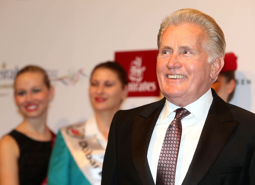 Actor Martin Sheen arrives on the red carpet at the opening of the 10th Dubai International Film Festival in Dubai, United Arab Emirates, Friday, Dec. 6, 2013.(AP Photo)
