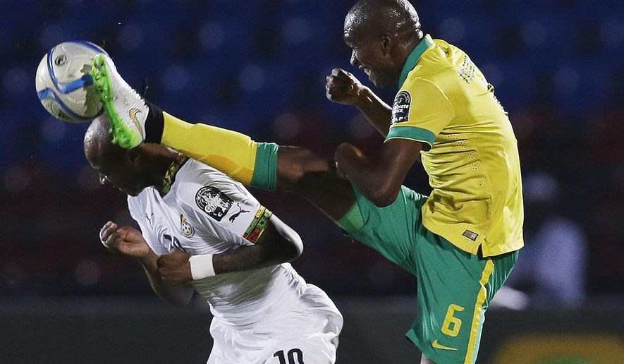 Ghana's Andre Ayew, left, is challenged by South Africa's Anele Ngcongca, right, during the African Cup of Nations Group C soccer match between Ghana and South Africa in Mongomo, Equatorial Guinea, Tuesday, Jan. 27, 2015. (AP Photo/Themba Hadebe)