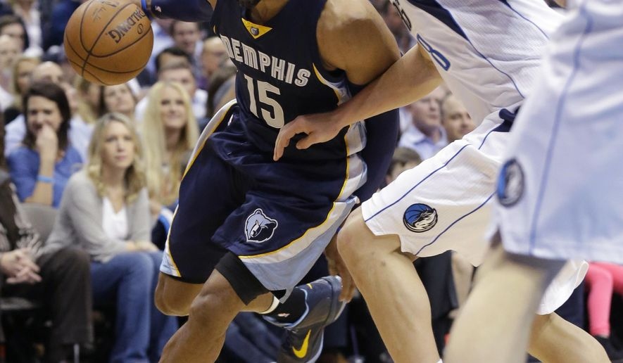 Memphis Grizzlies guard Vince Carter (15) drives against Dallas Mavericks forward Dwight Powell (8) during the first half of an NBA basketball game Tuesday, Jan. 27, 2015, in Dallas. (AP Photo/LM Otero)