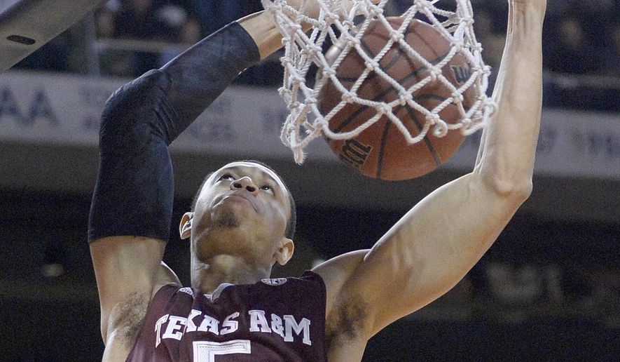 Texas A&M guard Jordan Green (5) scores during an NCAA college basketball game against Auburn, Tuesday, Jan. 27, 2015, in Auburn, Ala. (AP Photo/AL.com, Julie Bennett) MAGS OUT