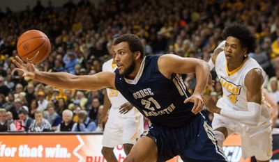 Geroge Washington forward Kevin Larsen, left, reaches for a rebound as VCU guard Justin Tillman, right, gives chase during an NCAA college basketball game at the Siegel Center in Richmond, Va., on Tuesday, Jan. 27, 2015.  (AP Photo/Zach Gibson) **FILE**
