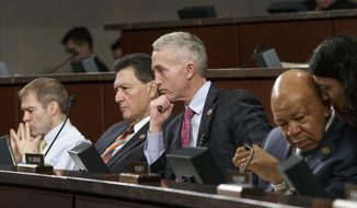 Members of the House Select Committee on Benghazi, from left, Rep. Jim Jordan, R-Ohio, Rep. Lynn Westmoreland, R-Ga., Committee Chairman Rep. Trey Gowdy, R-S.C., and Rep. Elijah Cummings, D-Md., the ranking member, listen to witnesses from the CIA and State Department on Capitol Hill in Washington, Tuesday, Jan. 27, 2015, as the panel held its third public hearing to investigate the 2012 attacks on the U.S. consulate in Benghazi, Libya, where a violent mob killed four Americans, including Ambassador Christopher Stevens.  (AP Photo/J. Scott Applewhite) ** FILE **