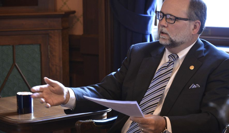 Sen. Arlan Meekhof, R-West Olive, the new Michigan Senate Majority Leader, hosts a media chat in his Capitol offices on Tuesday, Jan. 27, 2015, in Lansing, Mich (AP Photo/Detroit News, Dale G. Young)  DETROIT FREE PRESS OUT; HUFFINGTON POST OUT