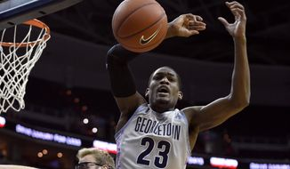 Georgetown forward Aaron Bowen (23) goes for a rebound against Xavier center Matt Stainbrook, back, during the first half of an NCAA college basketball game, Tuesday, Jan. 27, 2015, in Washington. (AP Photo/Nick Wass)